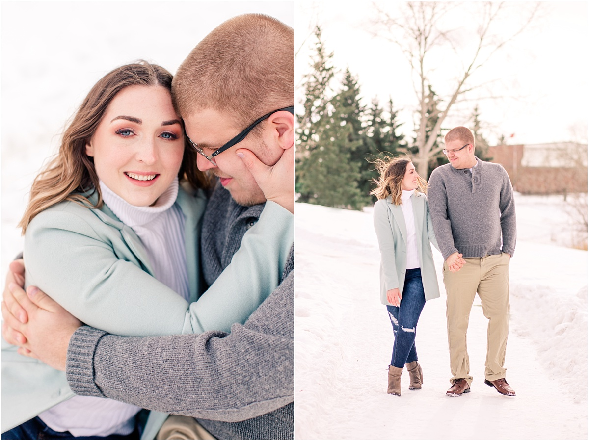edmonton engagement session with jillian and zack at the woodridge park in the winter couple is walking on the path smiling at each other