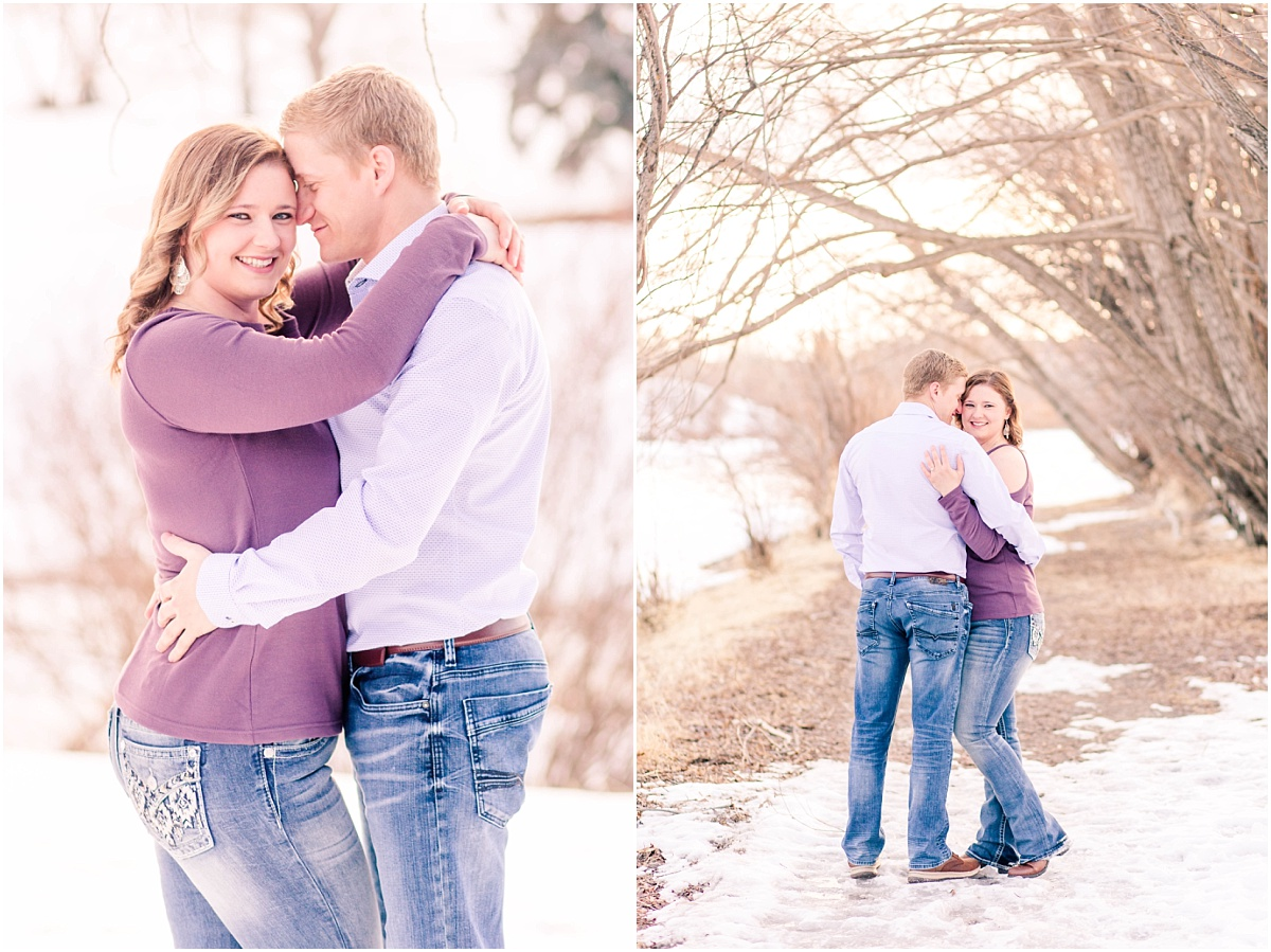 alisabeth and john at muskoseepi park path in grande prairie for engagement photos in the spring winter wearing purple shirt and jeans.