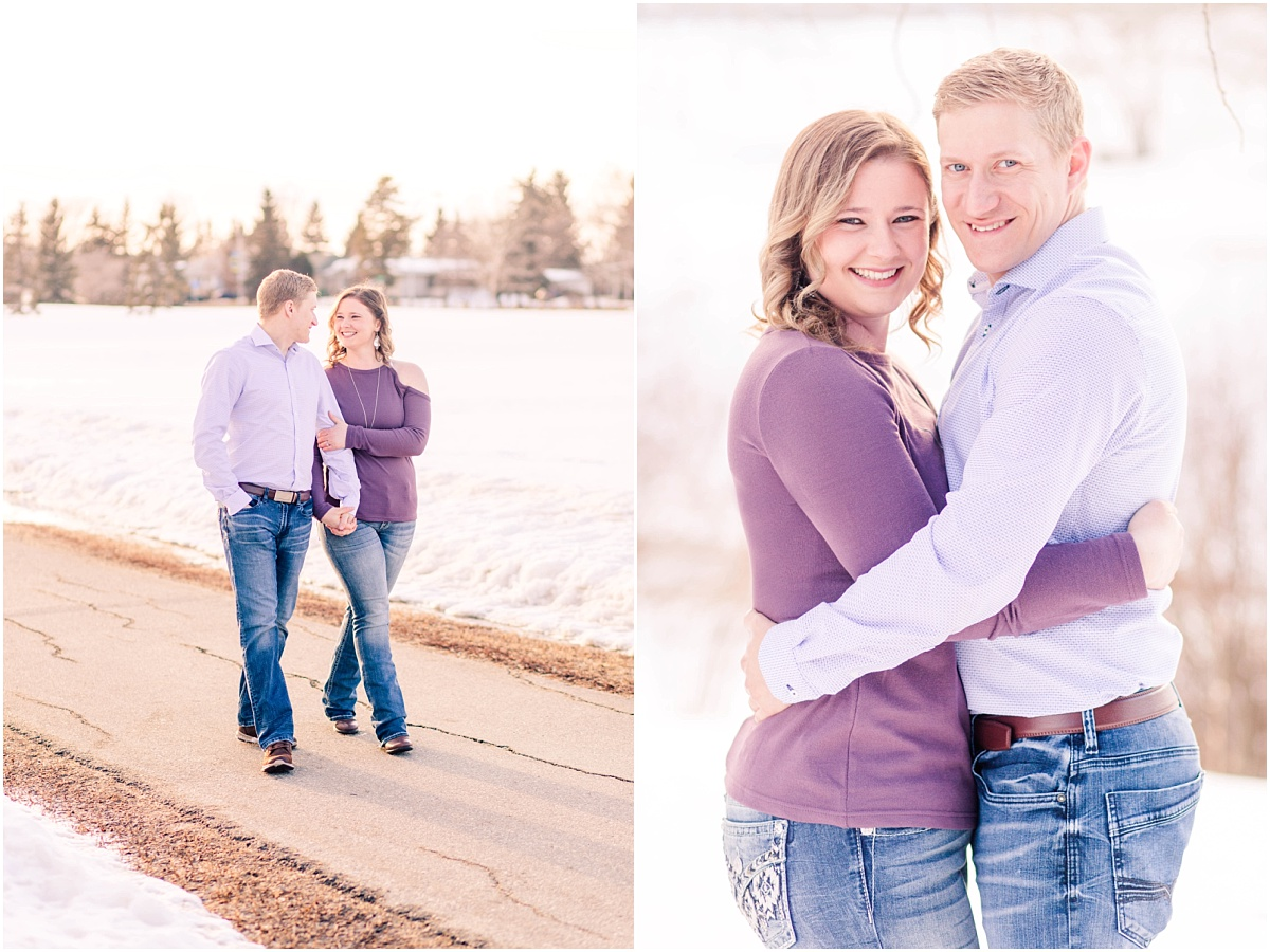 couple walking on path in grande prairie engagement photos smiling at the camera engaged couple