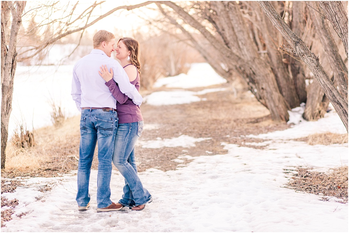 couple engagagement photos with photographer along muskoseepi park creek path with trees