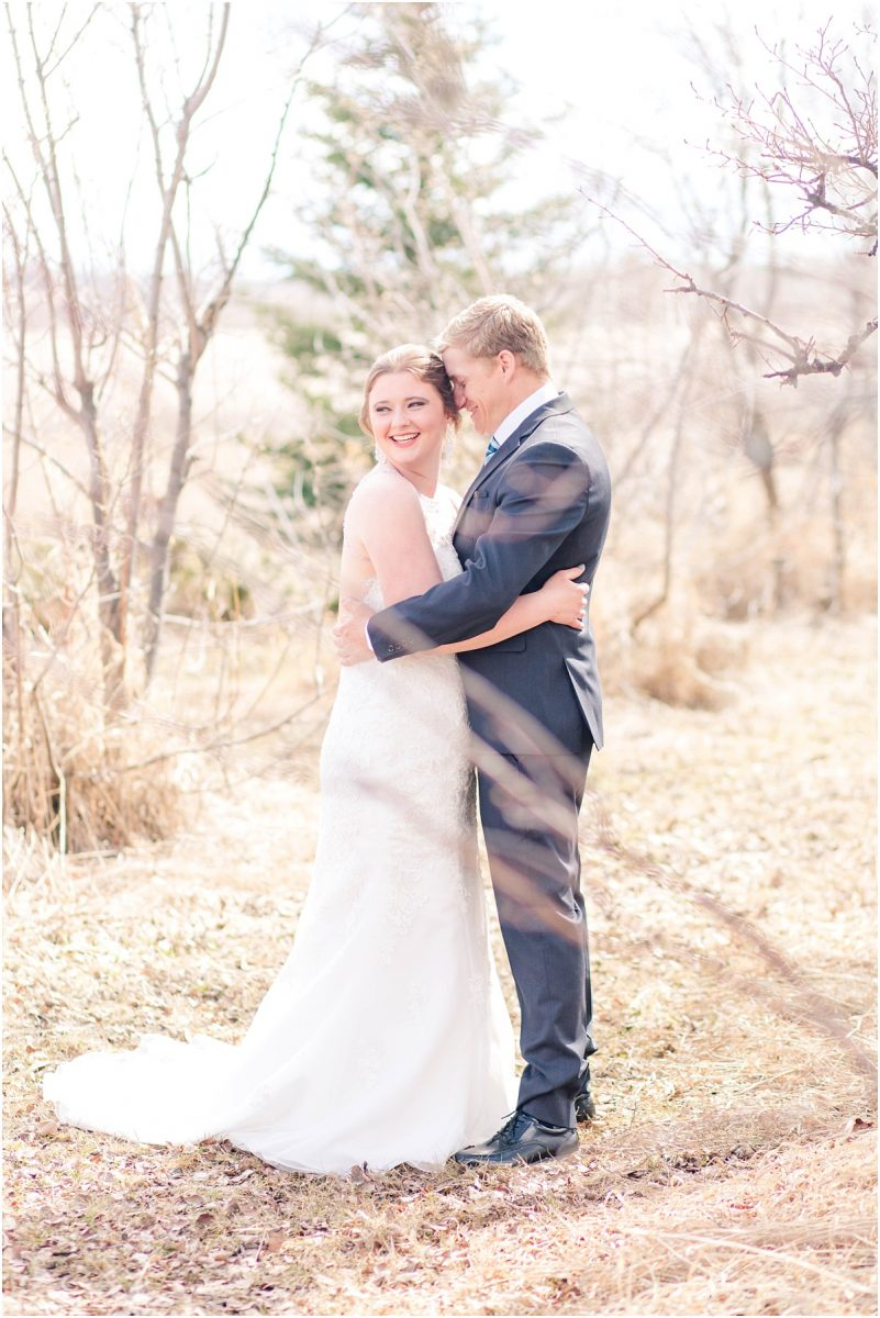 alisabeth and john chest to chest verticle photo with light wedding photos