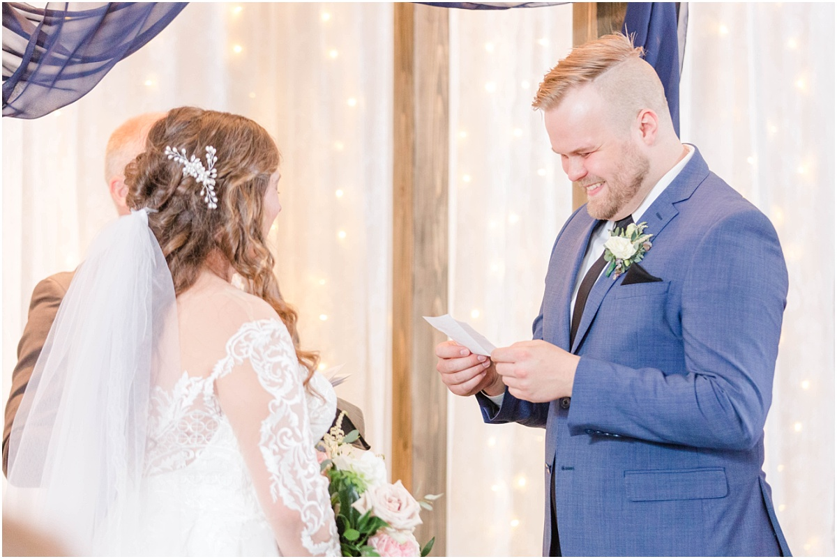 groom reading vows during covid ceremony for their wedding photos with wedding photographer