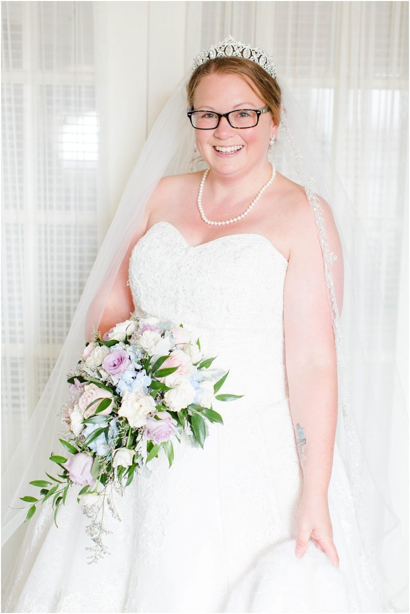 bride getting ready in edmonton for small intimate wedding ceremony with flowers