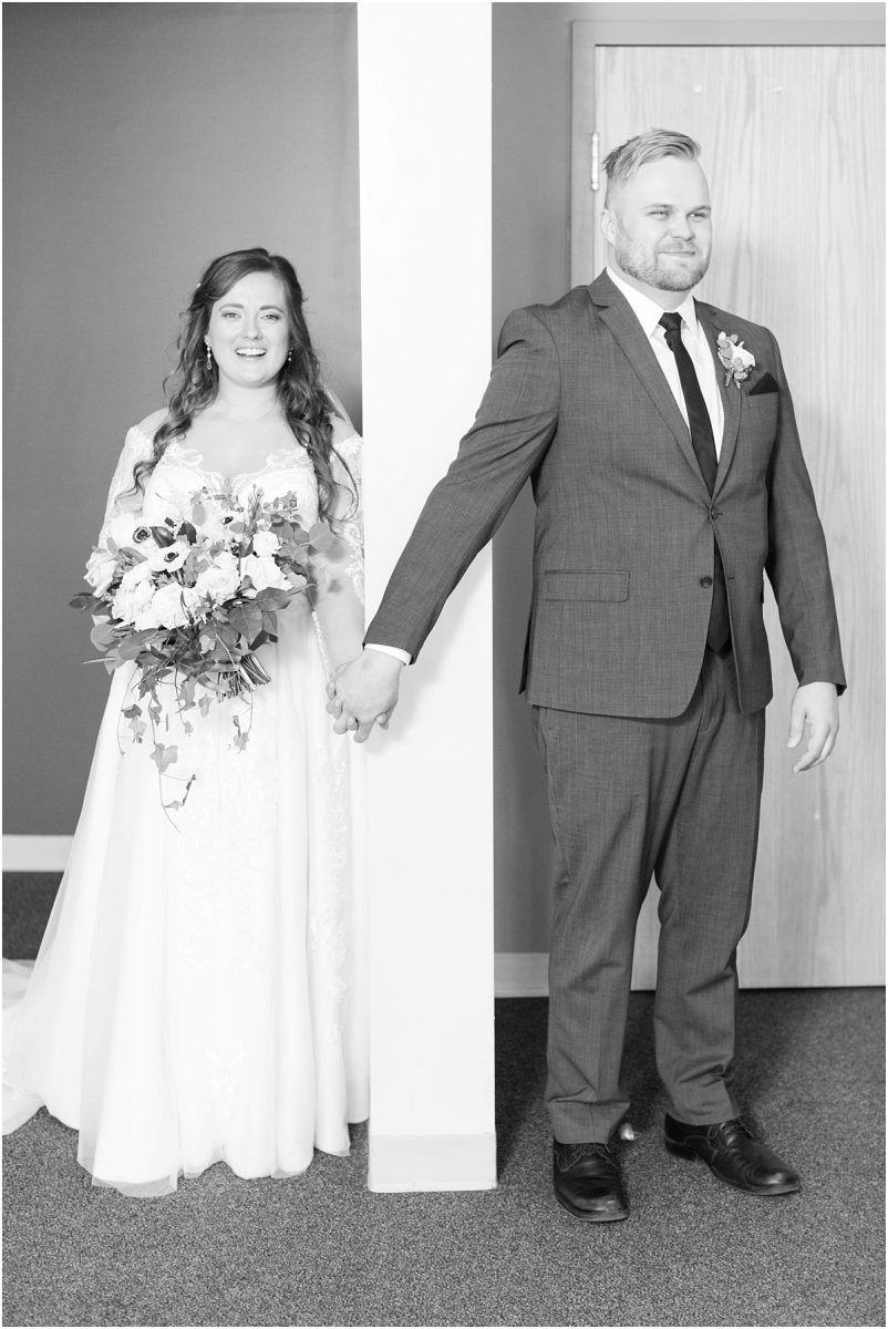 bride and groom blind first look holding hands wedding photos in grande prairie