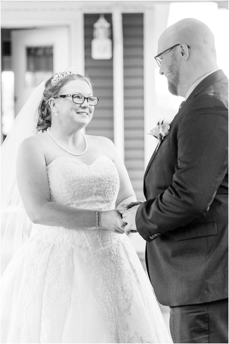 bride with tears running down her eyes ceremony holding her grooms hand black and white emotional photo