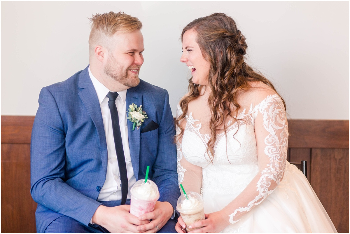 bride and groom laughing starbucks in grande prairie on their wedding day cobblestone grande praiire small wedding