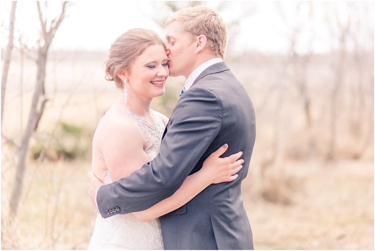 groom kissing bride for their wedding first look photos in alberta super sweet moment close up photographer