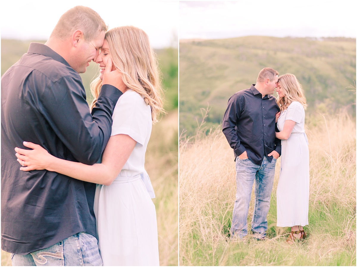 denny and chantelle romantic engagement photos on top of hill dunvegan near fairview