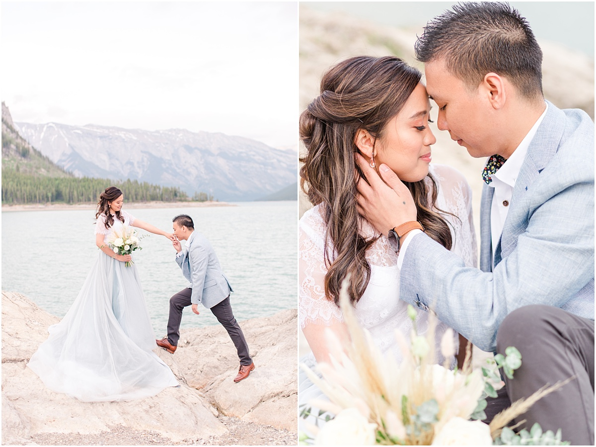 groom kissing bride's hand with mountains in the background in banff canadian rockies with their wedding photographer that captured it all