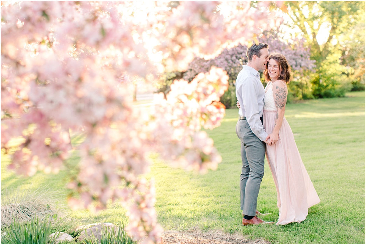 beautiful creative photo captured by kayla lynn photography of couple in the blossoms in grande prairie for their anniversary