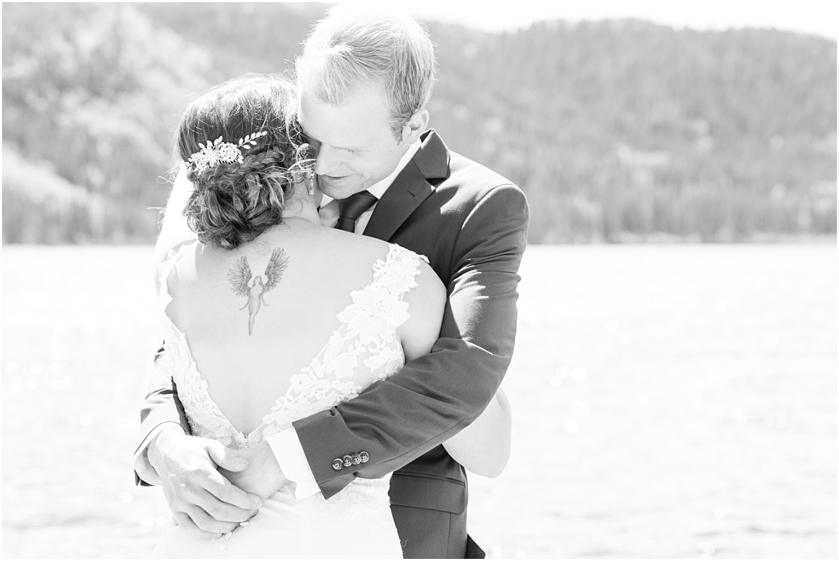 first look with bride and groom danial and shelbee at the grande cache lake very sweet black and white close up photo