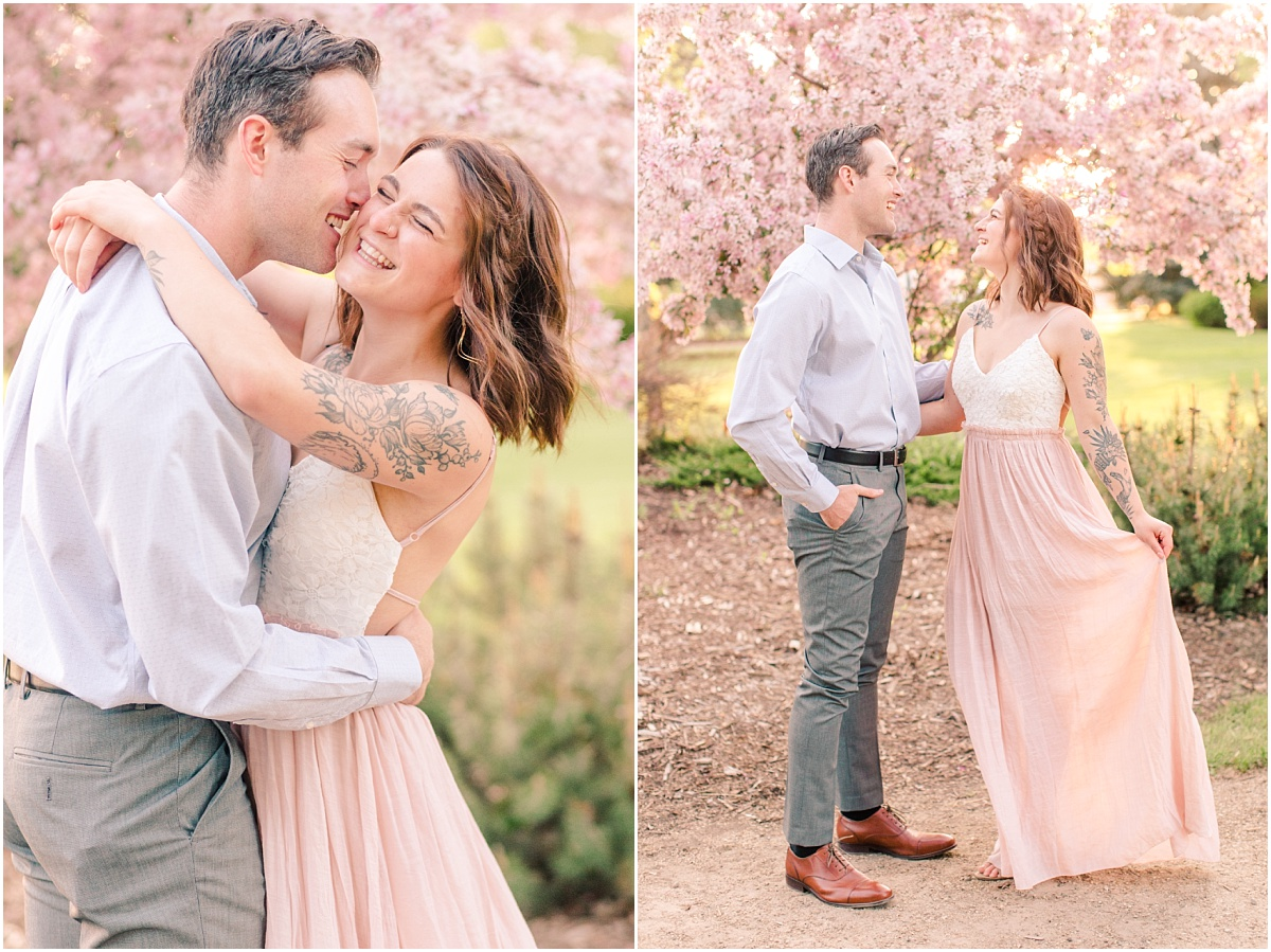 cassie and patrick with the blush and white dress in front of the beautiful blossoms in grande prairie