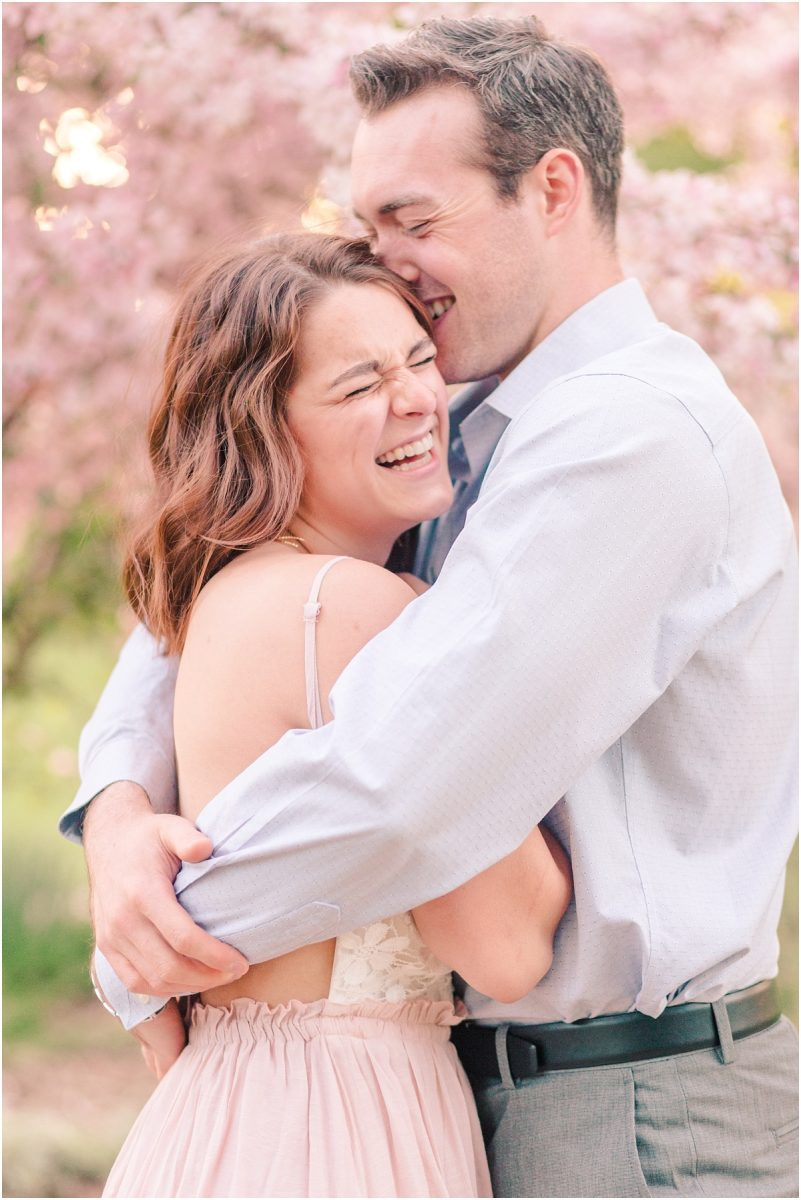 candid engagement photos couple that is happy close up with their photographer in grand prairie alberta as they hug each other