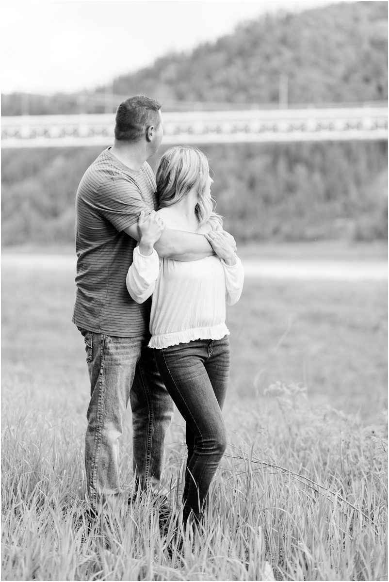engagement photos b;lack and white with dunvegan bridge in the background