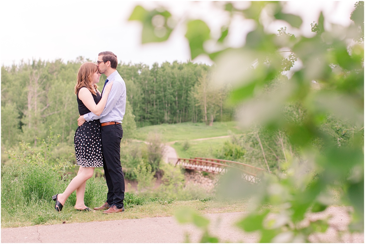 engagement photos with lindsay and eric wearing blue and black poka dot dress with heals