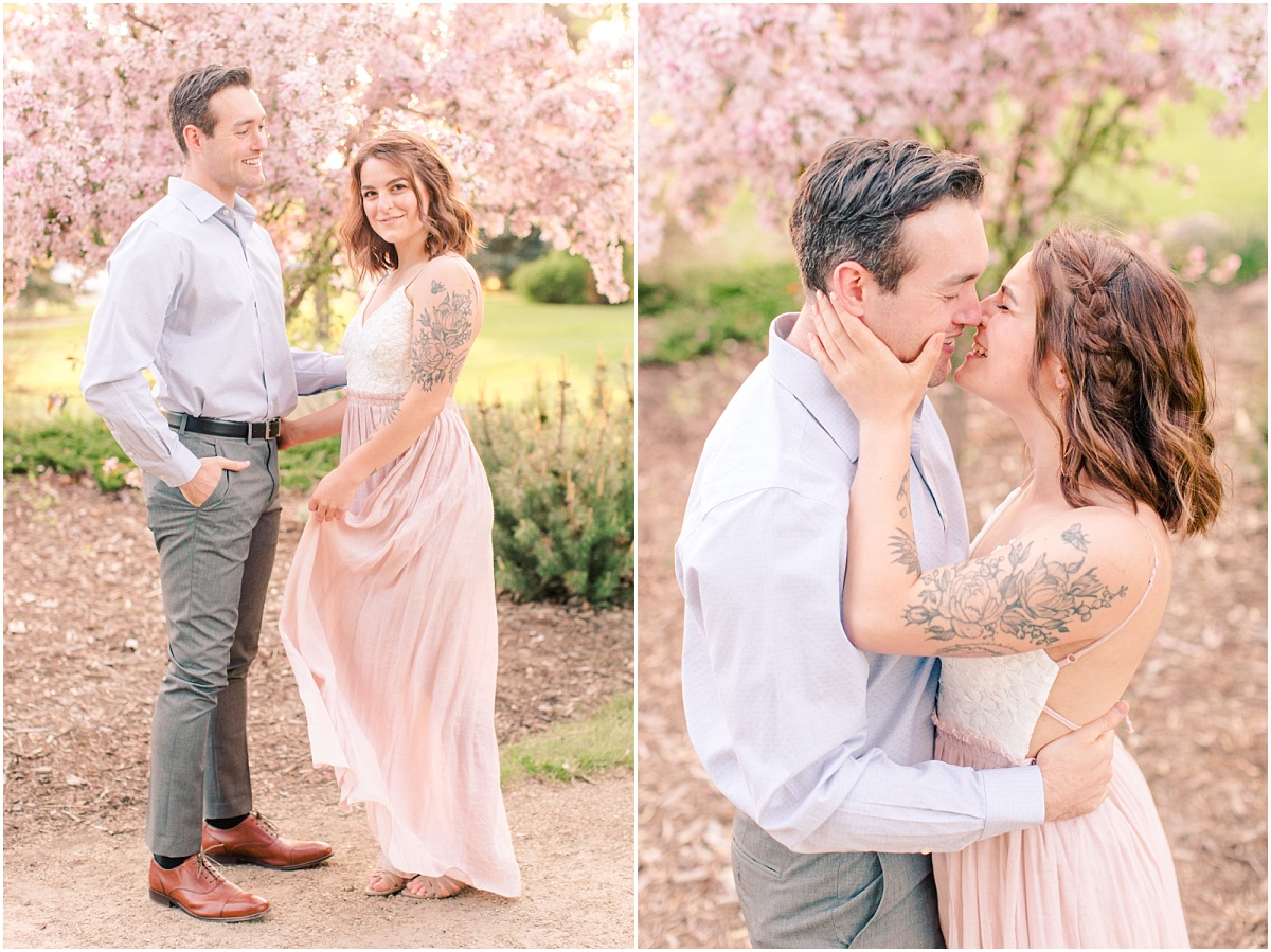 romantic engagement anniversary photos with flowy blush dress with all the blossoms and greens in the spring in grande prairie alberta very light and airy