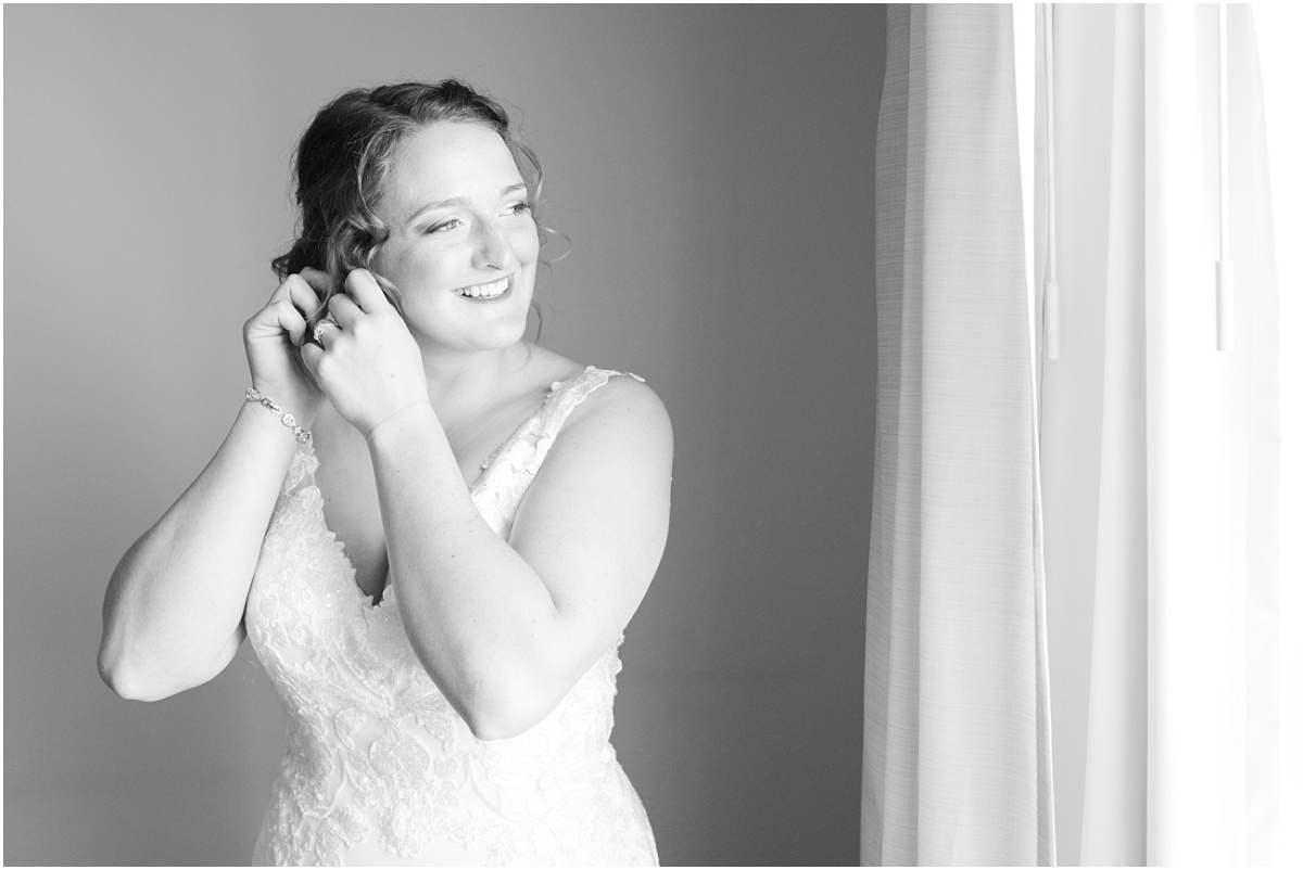 bride getting ready on her wedding day at the grande cache hotel