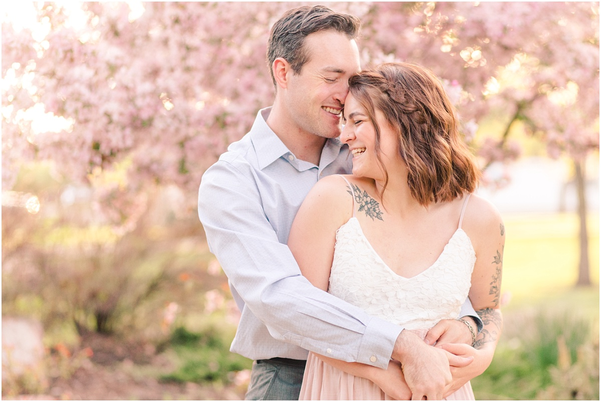 close up photos of cassie and patrick for their anniversary couples wedding photos out at julibee park with the blossoms in grande prairie