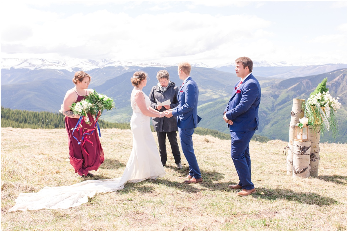 grande cache wedding on grande mountain small ceremony elopement and their photos with small bridal party and beautiful view sunlight
