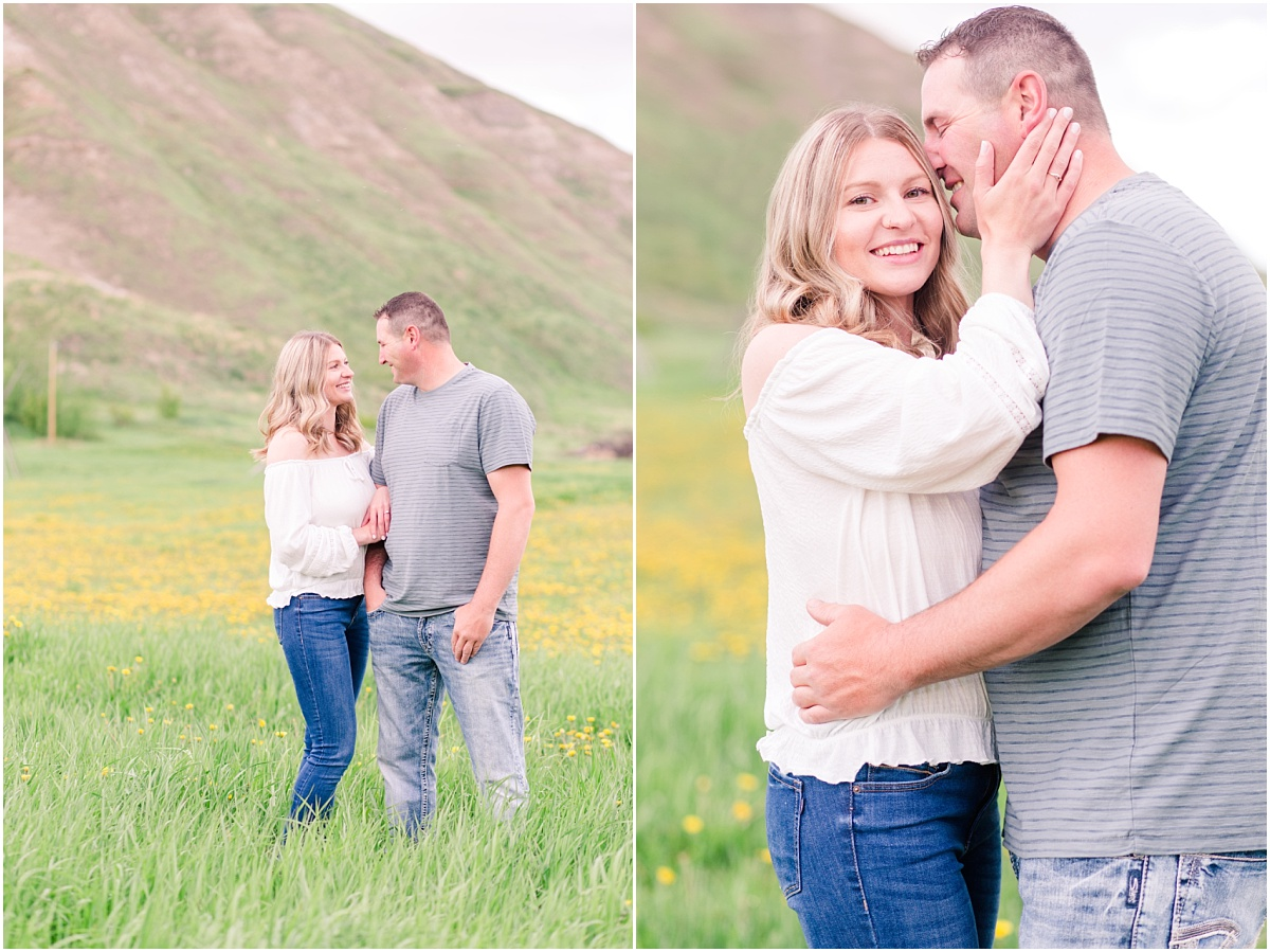 couple standing with hill i the background for their dunvegan engagement photos near fairview