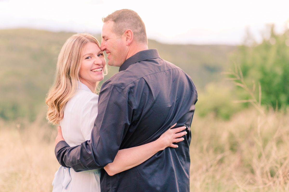 grande prairie wedding photographer for denny chantelle engagement photos at dunvegan near fairview close up photo of chantelle wearing light blue dress black shirt