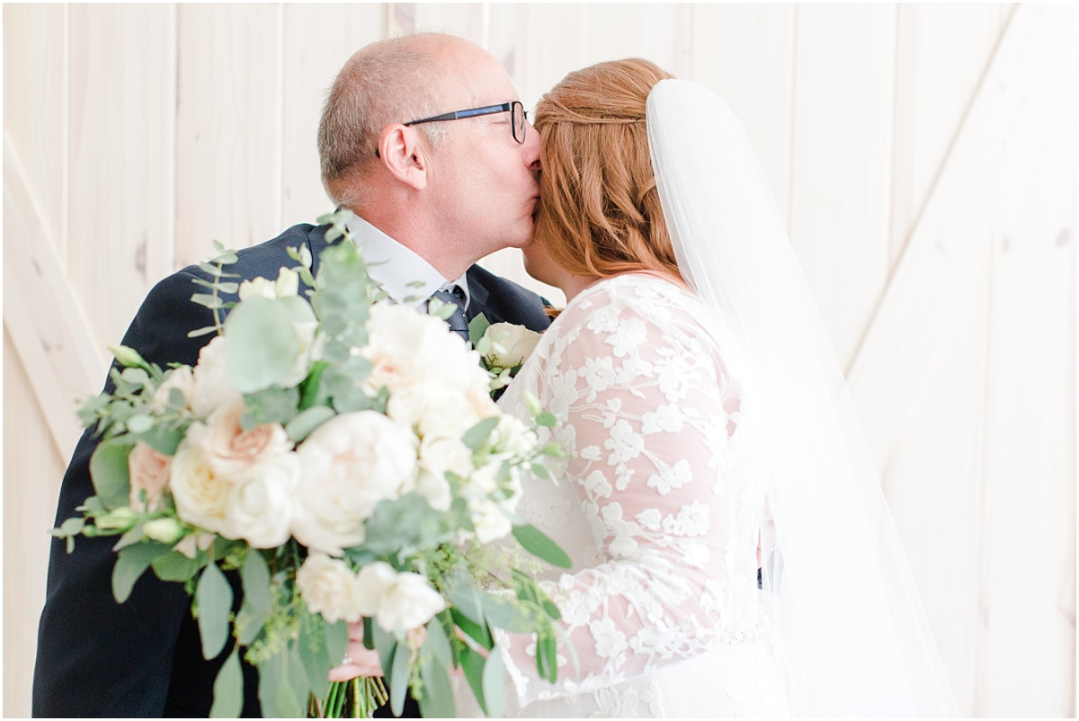 daddy daughter first look kiss lots of emotion and tears on brides wedding day