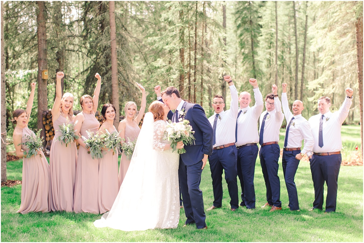 fun bridal party fist pump in the airy for their backyard covid style wedding