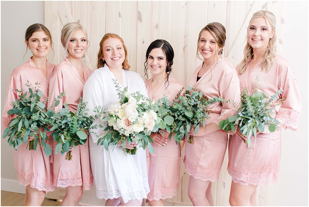 bridemaides photo wearing robes blush holding their bouquets from grower direct
