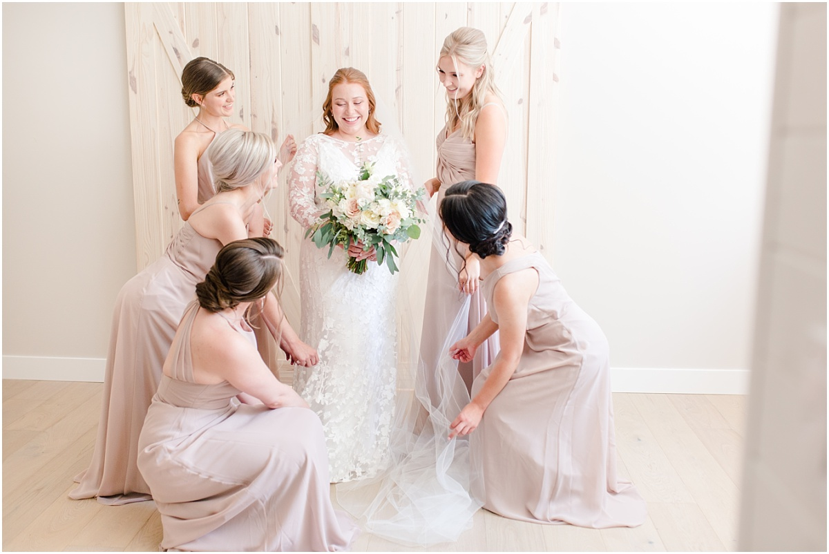 kj style alberta wedding photographer bridemaids with dresses on candid photo