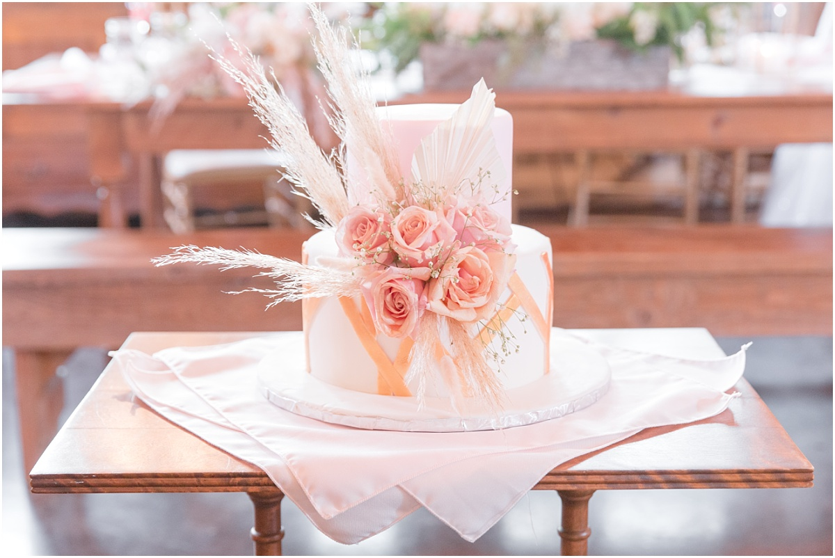 wedding cake flowers by little petal co with pampas grass