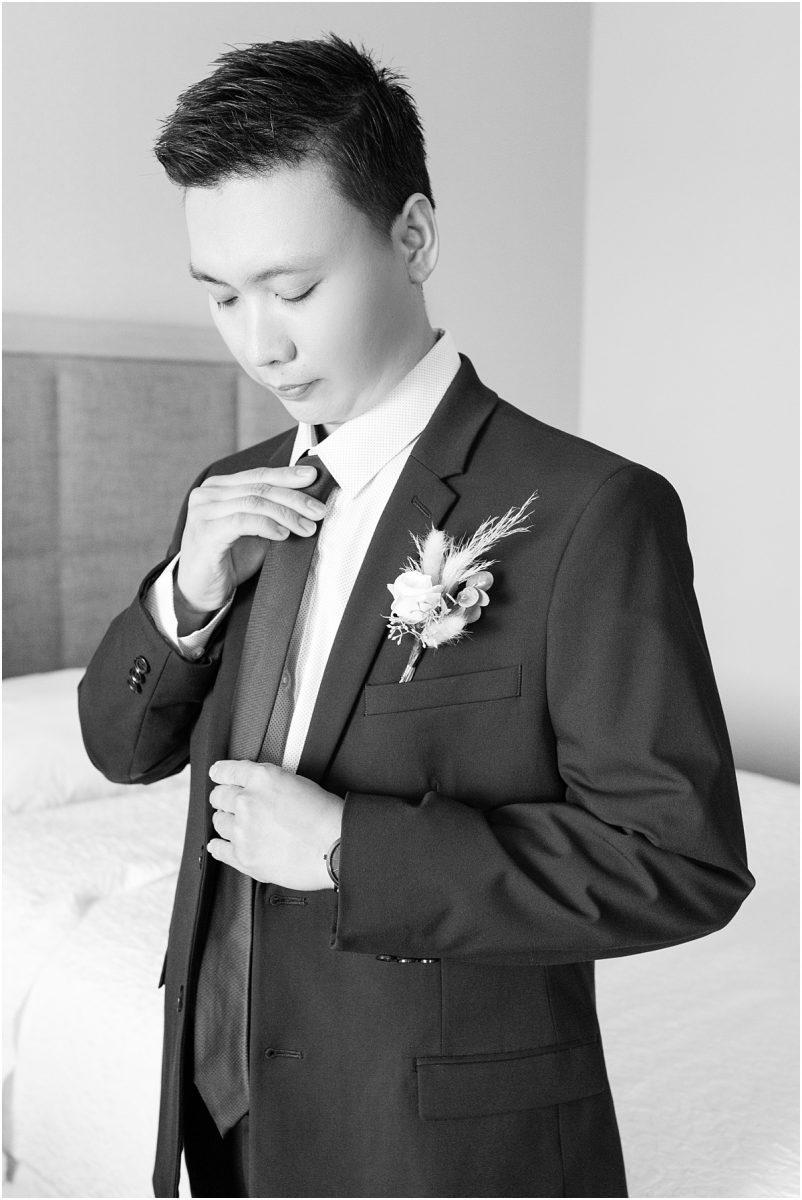 groom getting ready at the hampton hotel inn grande prairie for wedding photos