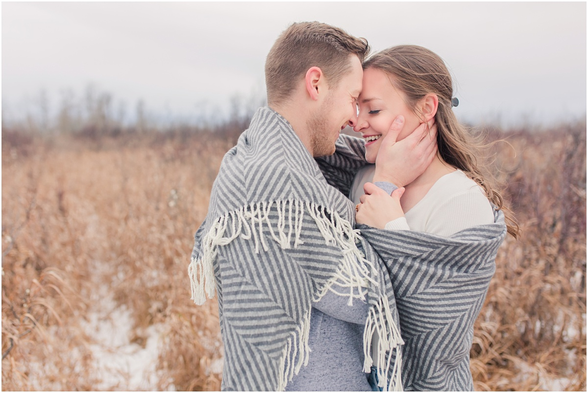 photos with shailene and brodie under wrapped around blanket at saskatoon island provincial park in grande prairie wembly with wedding photographer