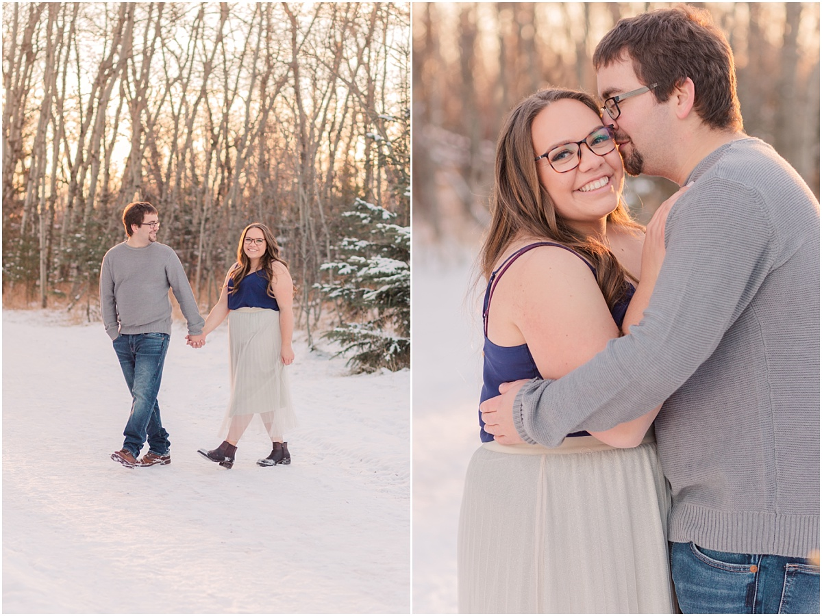 couple walking in the snow for their winter engagement photos with light spruce trees tulle grey skirt pinterest