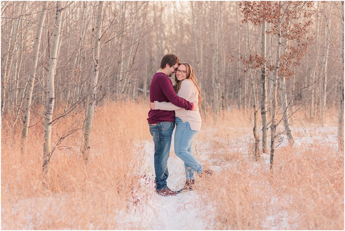 fall winter engagement photos with deanna and damon with light golden grass wearing burgundy shirt and cream shirt