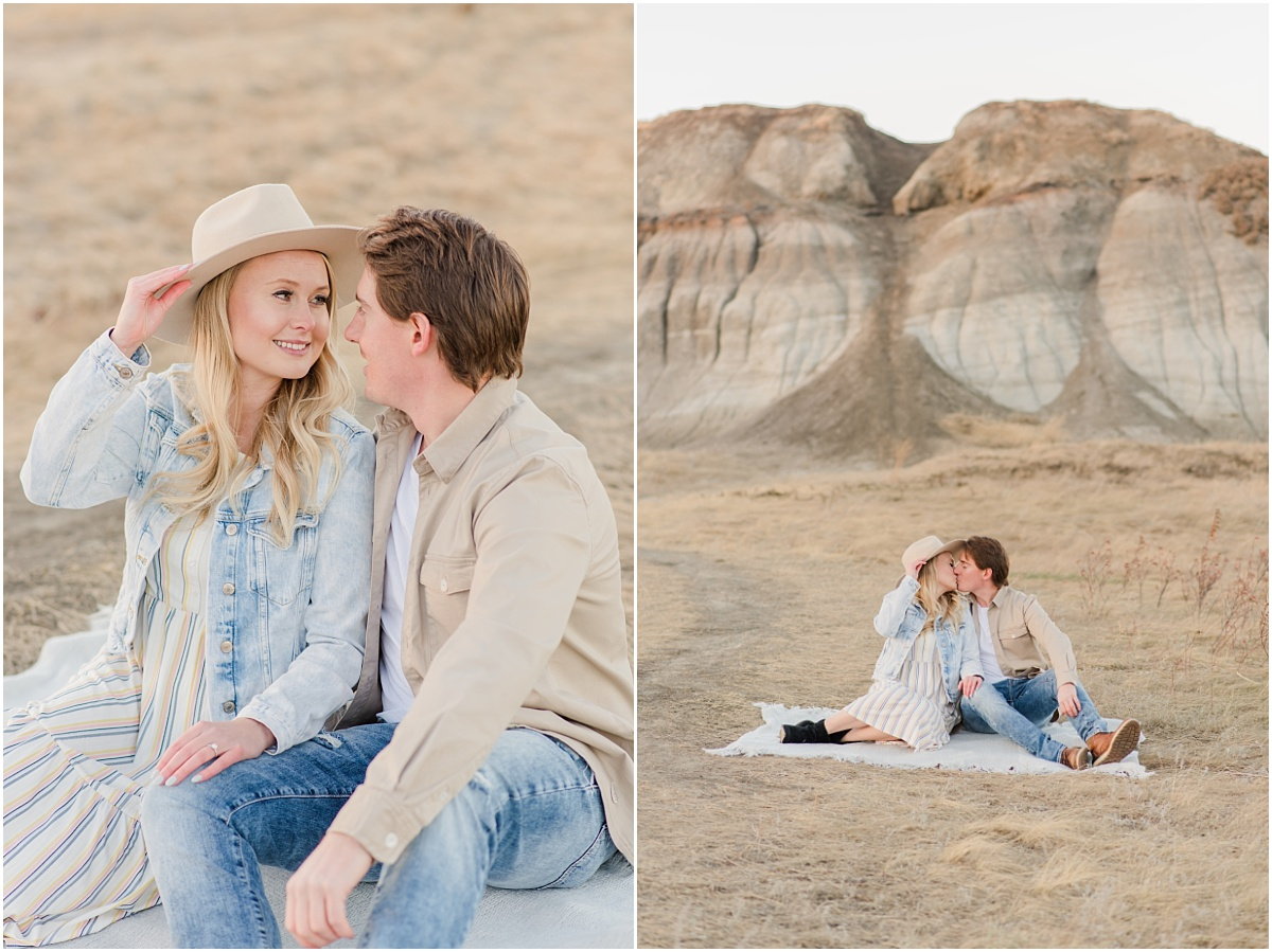 couple sitting on cream blanket with the kleskun hills in the background for their engagement phots with light blue and tan and creams colors for their stylist pinterest outfits