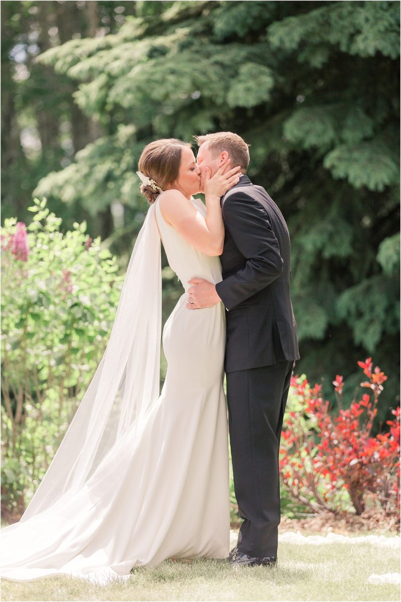 first kiss of the bride and groom shailene and brodie at serenity acres natural outdoor ceremony in grande prairie