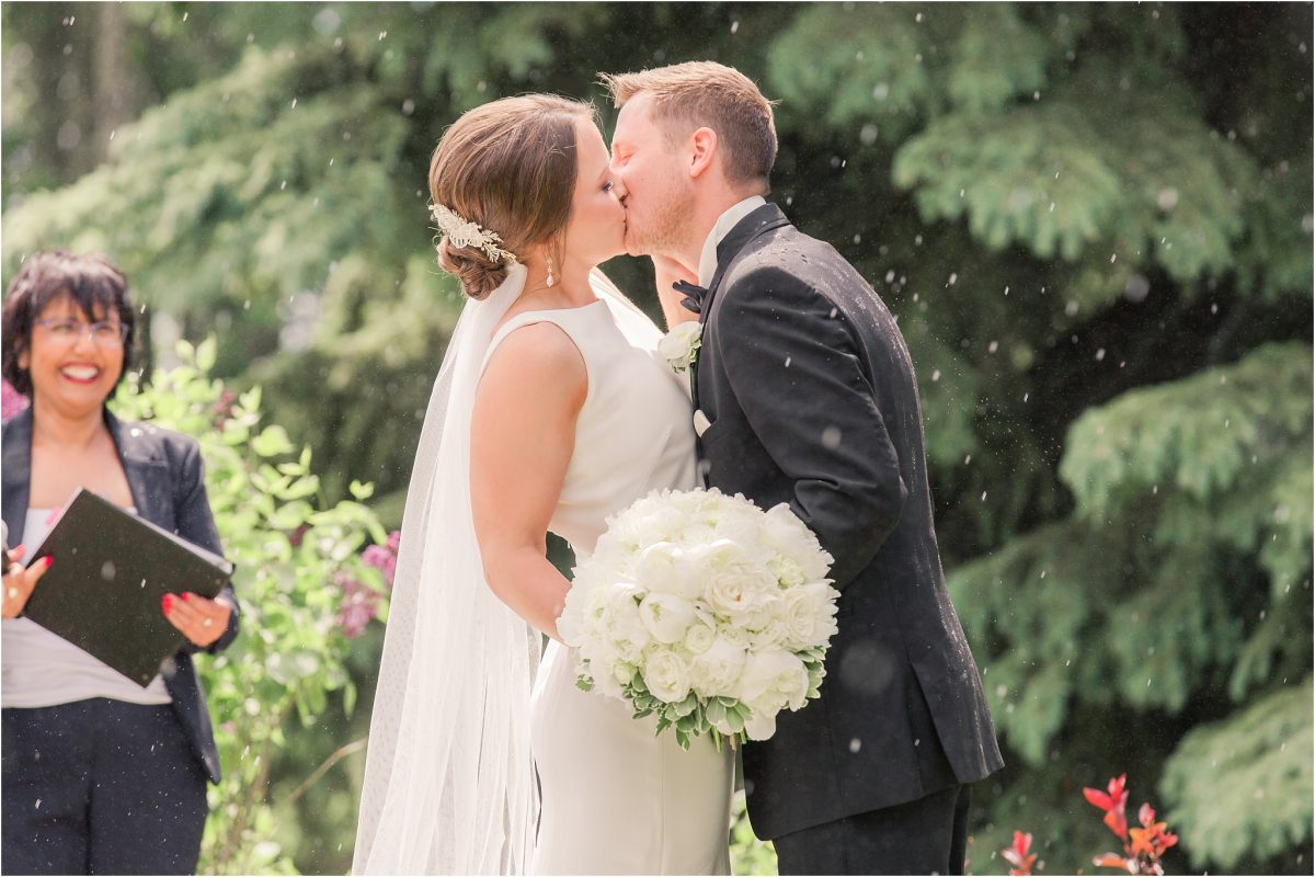 rain during the ceremony at serenity acres couple kissing in the rain magical good luck moment