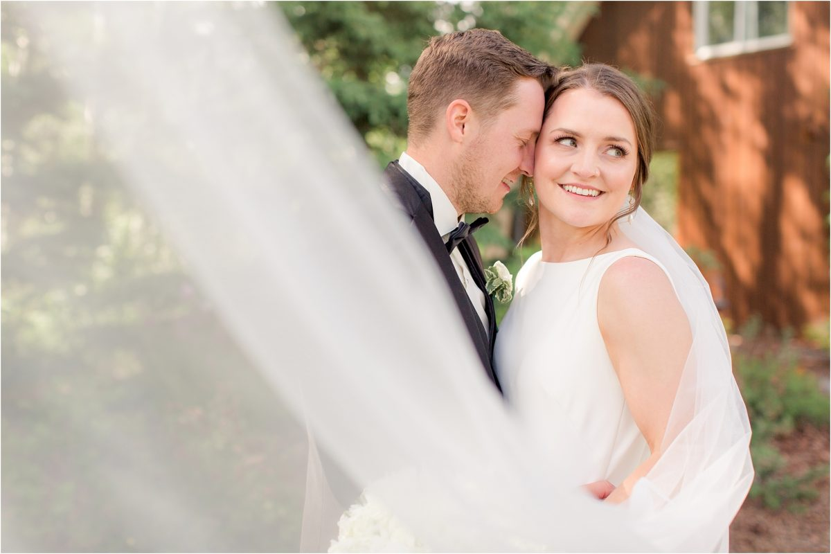 veil shot of shailene with her long veil with barn in the background
