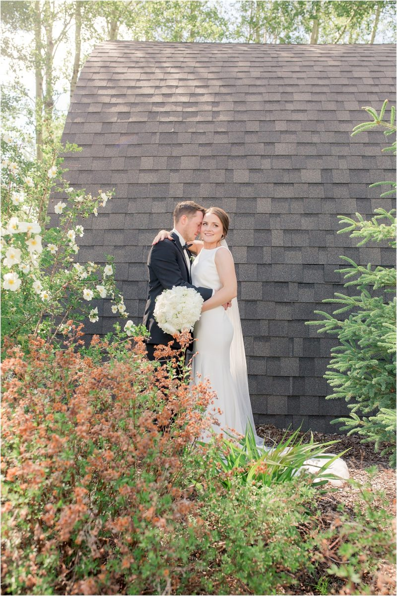 wedding photographer with shailene and brodie at serenity acres with black building in the background