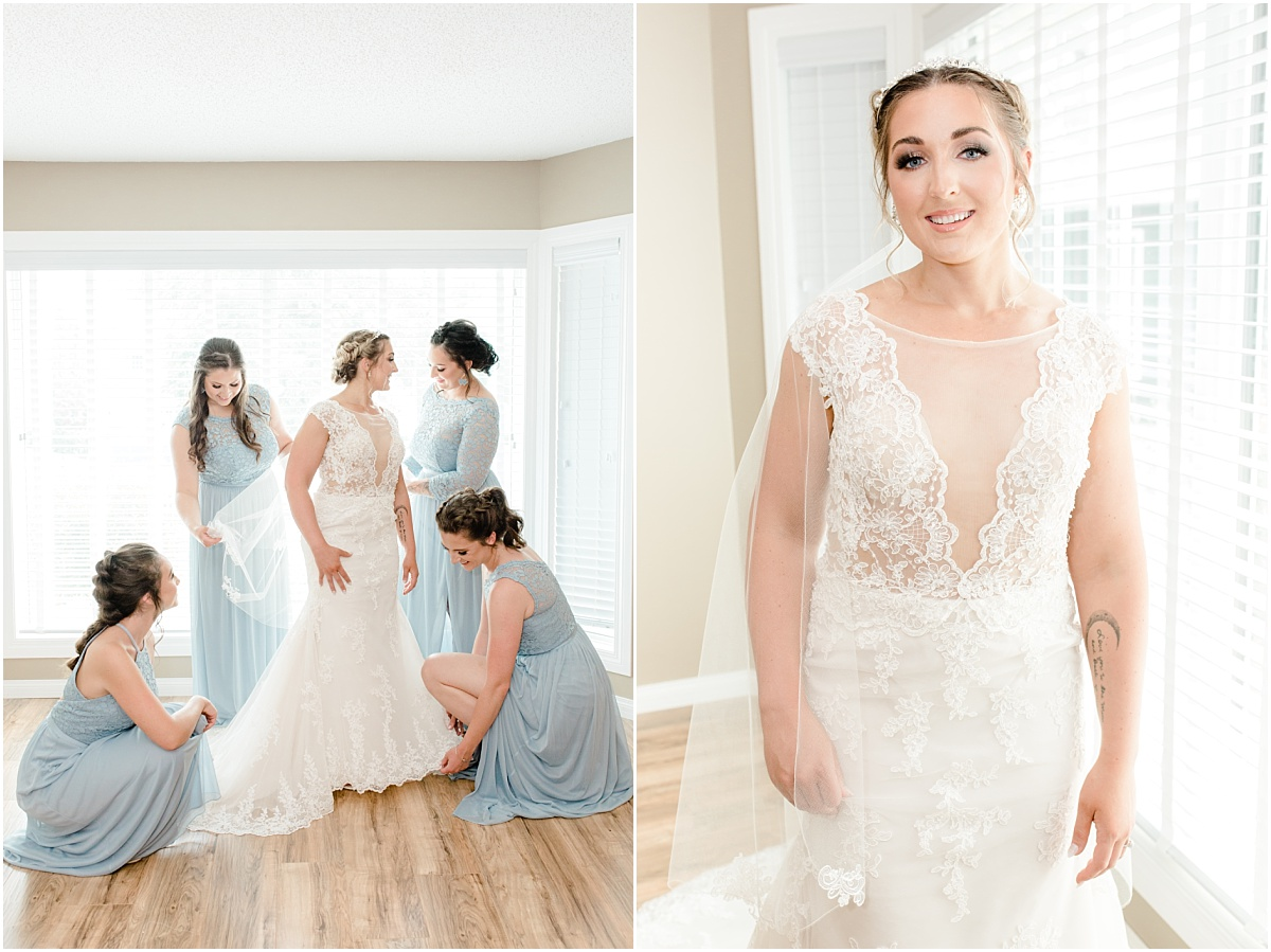 light and airy getting ready photos in sheerwood park bridemaids wearing dusty blue dresses beautiful close up smiling bride