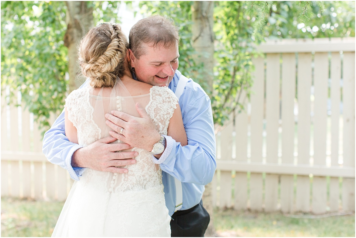 father of the bride daddy daughter first look giving hug outside close up photo in sheerwood park for wedding