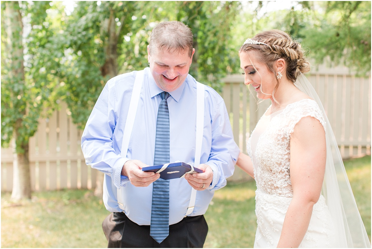 bride giving father gift morning of the wedding after the first look happy dad