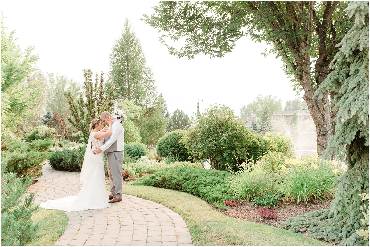 wide shot of bride and groom wedding photos at the sheerwood park garden center