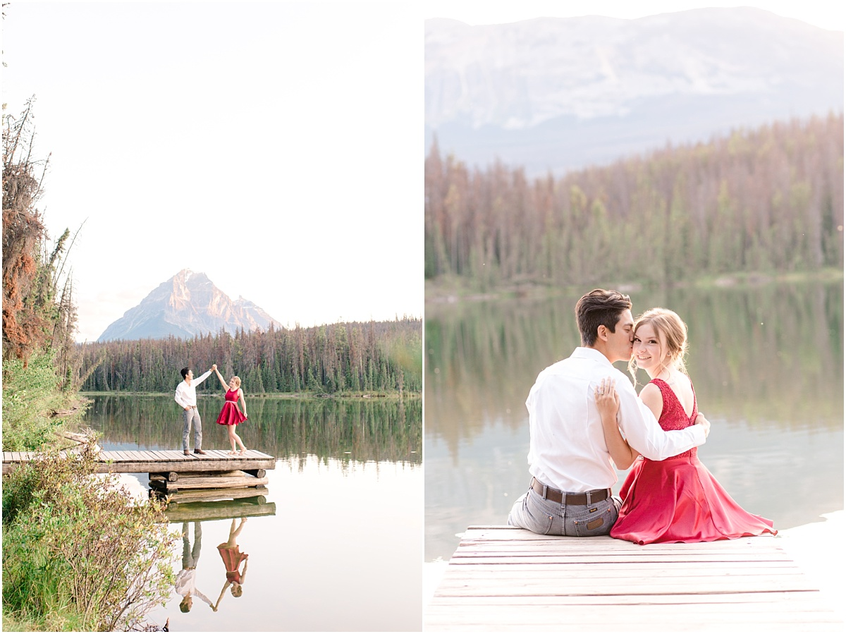 camden and cass sitting on the leech lake jasper dock for their dreamy light and airy engagement photos twirling far shot photos