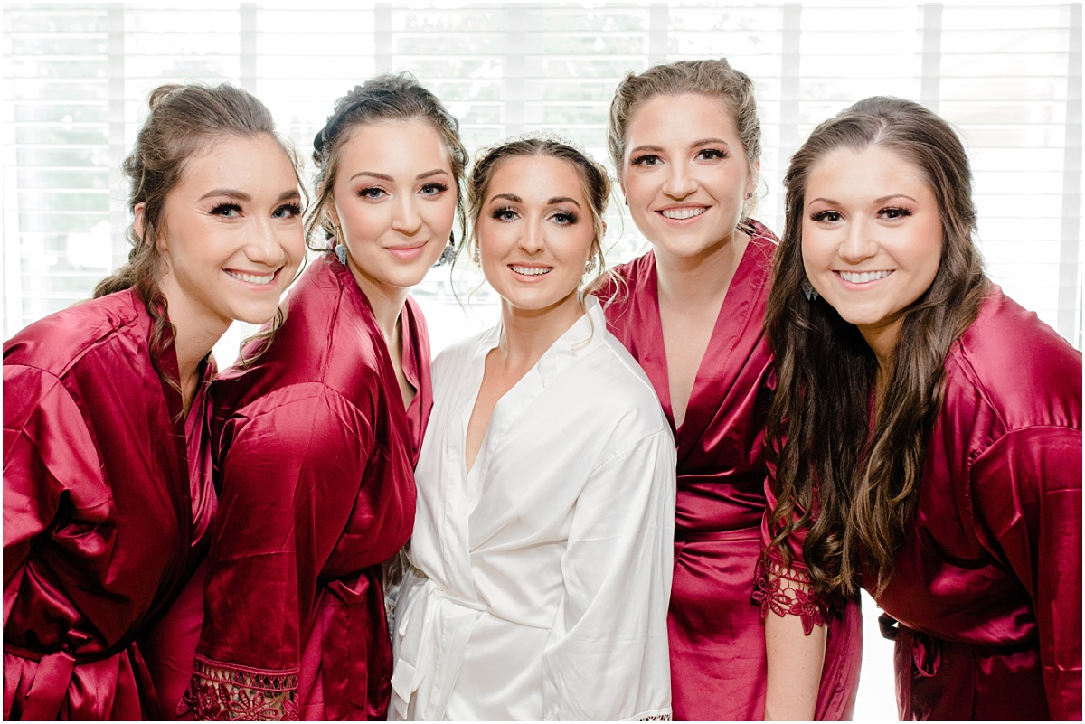 bridemaids robe shot smiling at the camera happy bridesmaids in their burgundy custom etsy robes