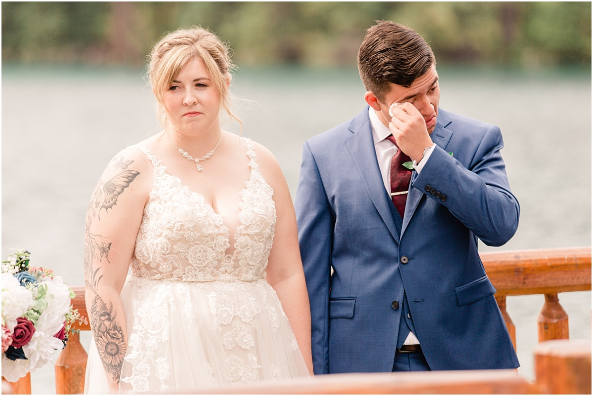 groom whipping tears during ceremony very emotional and beautiful wedding photos